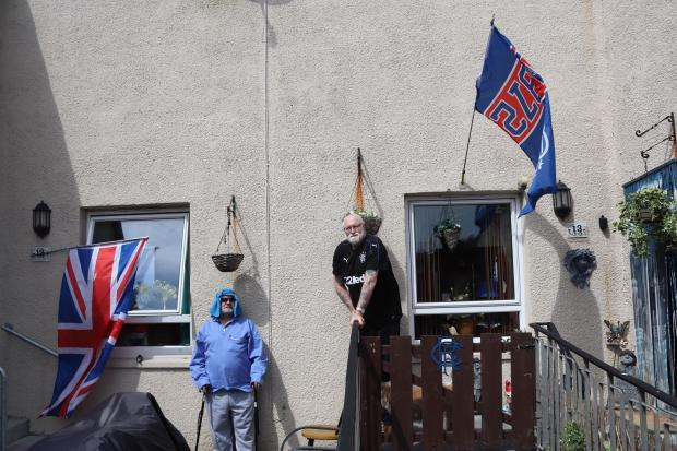 Ayr Advertiser: Joe (left) and Duncan (right) display flags and a Rangers crest at the their homes