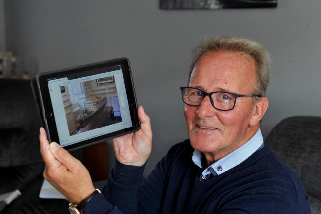 Dougie Graham with a photo of boat he wants back in Troon.