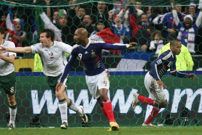 France's Thierry Henry (right) celebrates after setting up William Gallas to score