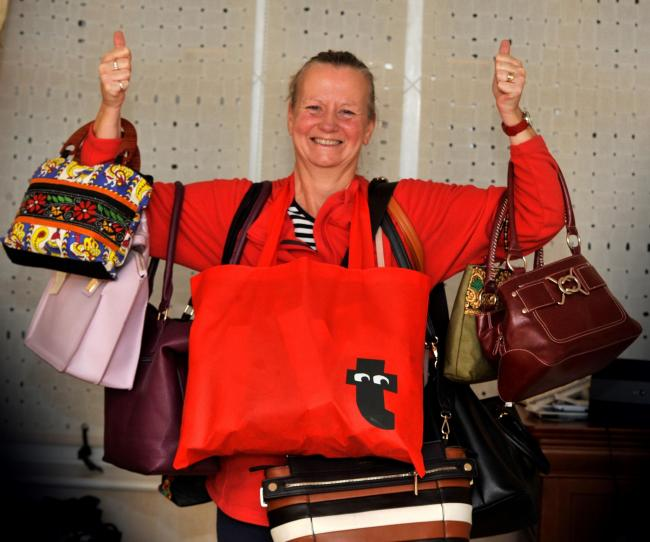 Tracy Bayne with handbags which have been donated to her, Ayr.
