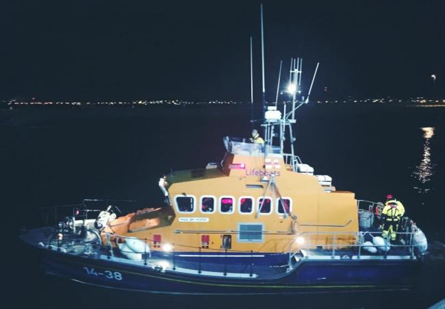 Person rescued from the water by lifeboat crew at Troon Harbour