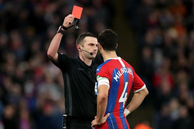 Michael Oliver sends off Crystal Palace's Luka Milivojevic after referring to the pitchside monitor