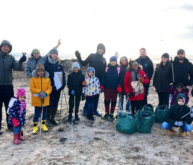 Families from Refugee Survival Trust on Troon Beach.