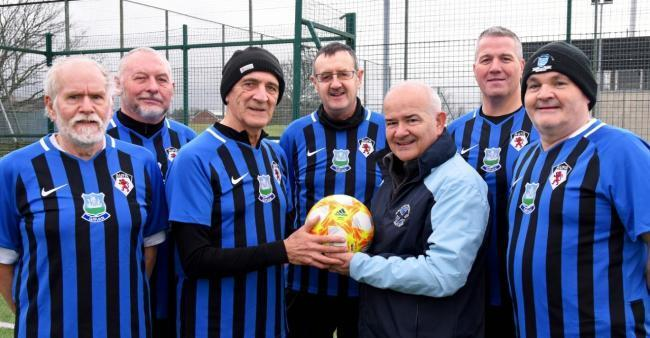 Campbell Frame, pictured holding a ball, with Walking Football chief Gary McLaughlin.