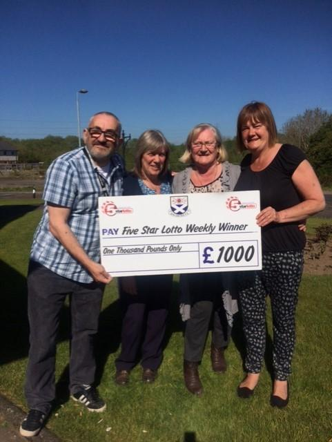 GRAND DAY: Pictured is the winner Rena Murray from Drongan with Five Star Lottery boss Dougie Morton, agent June Morton and Fiona Trousdale from the Toll Bar, Drongan.