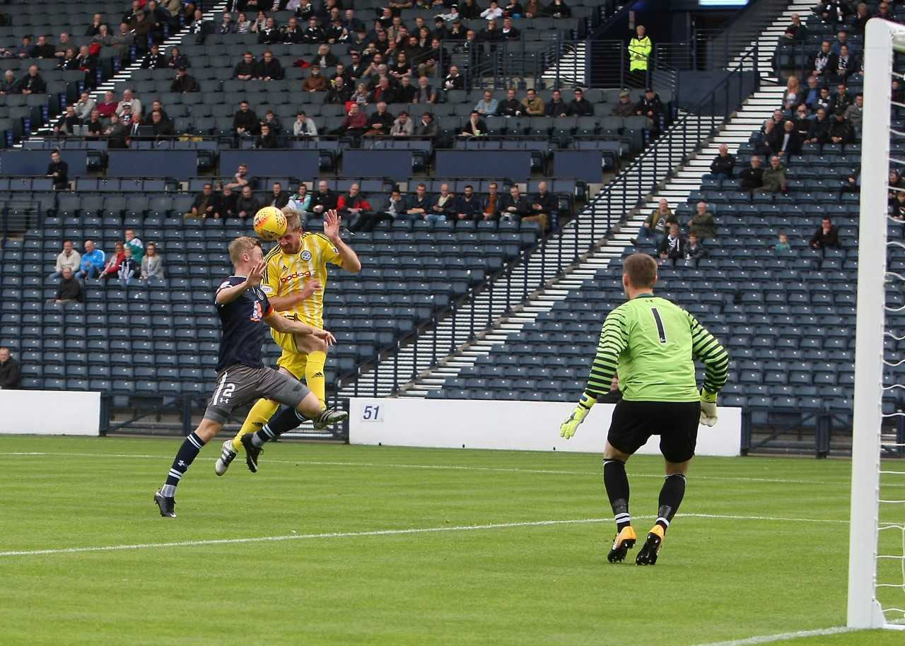 GREAT FINISH: Jamie Adams heads Ayr into the lead at Hampden. Now they aim to see off East Fife at home.
