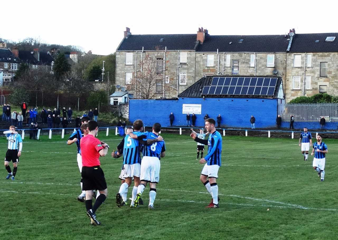 HAPPY DAYS: Girvan players celebrate their goal at Dunterlie Park. Picture by Robert Burns.