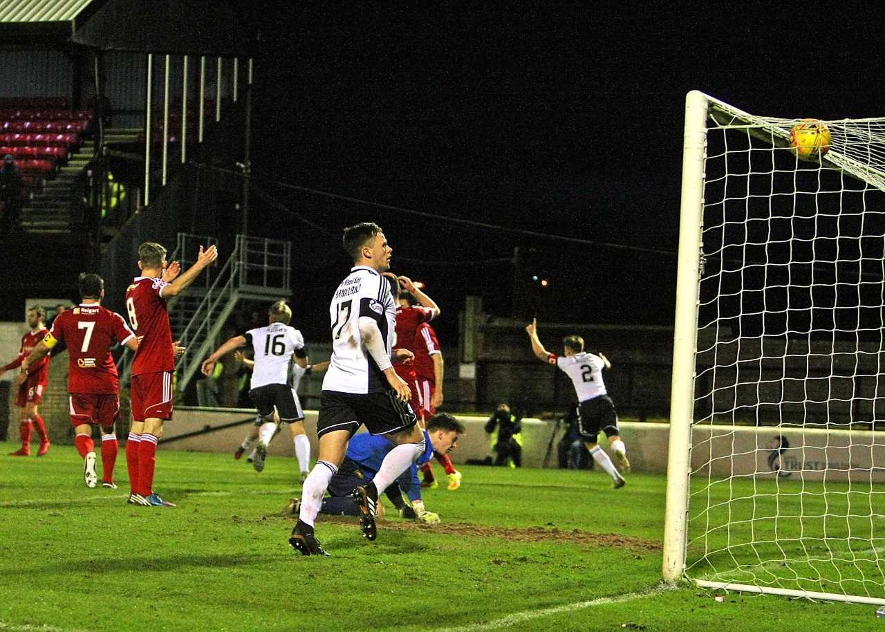 SWEET REDEMPTION: Chris Higgins scores the winner for Ayr United to atone for his earlier mistake.