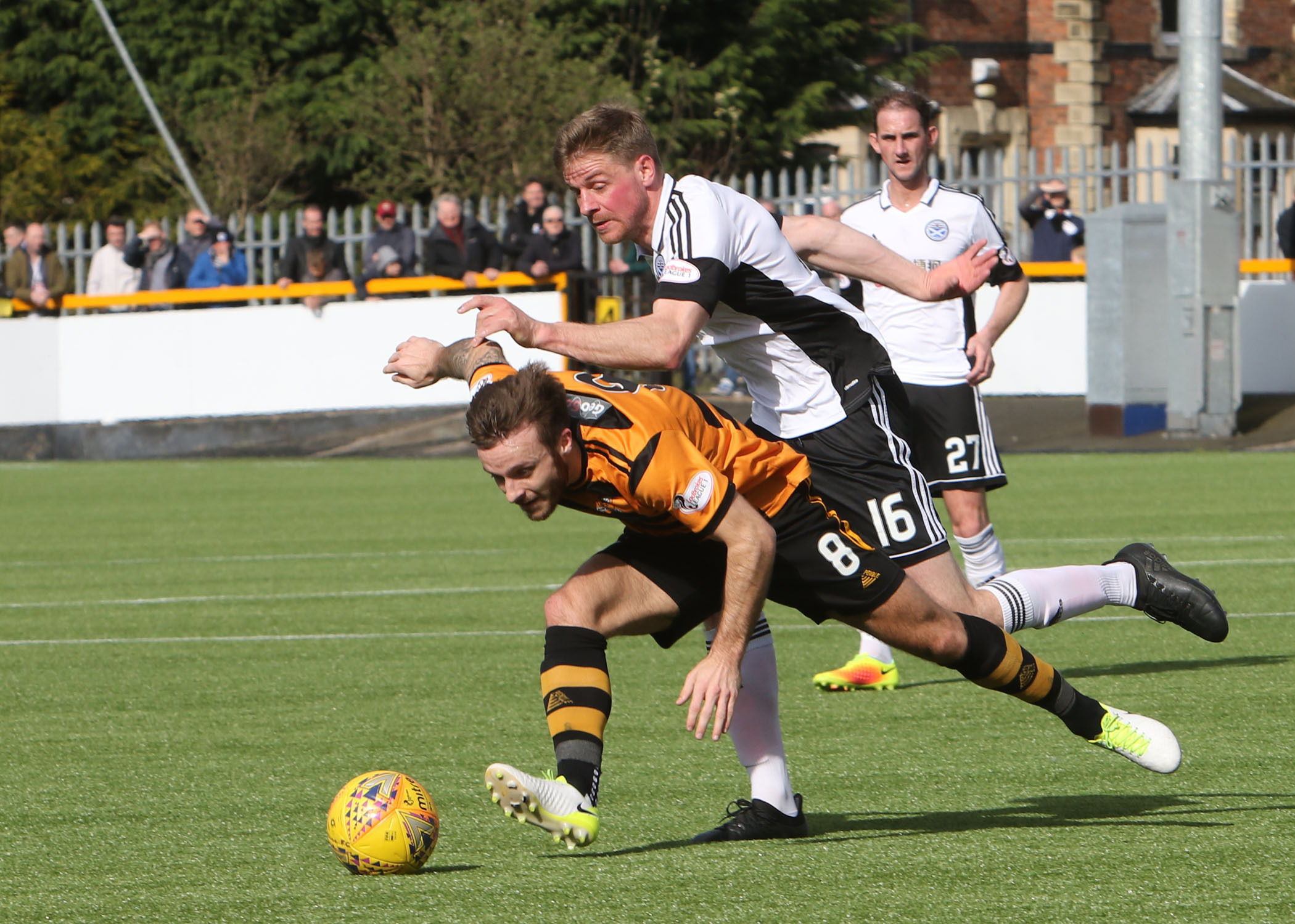 TESTING MATCH: United's Jamie Adams battles with Alloa's Steven Hetherington  in midfield.