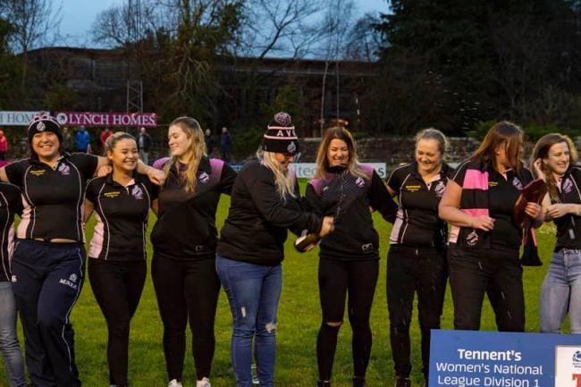 CENTRE STAG£: Ayr Ladies show off their national trophy at half-time at Millbrae.