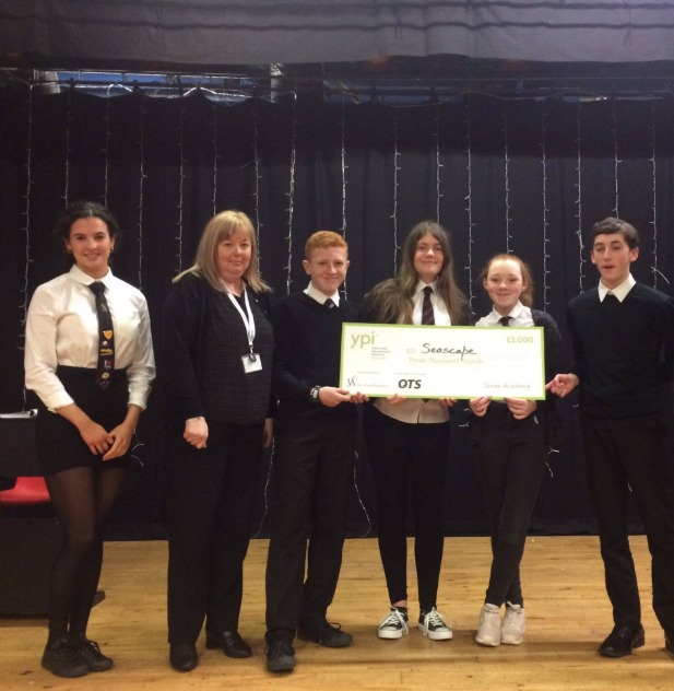 Pupils met with chosen charity seascape to present their cheque
