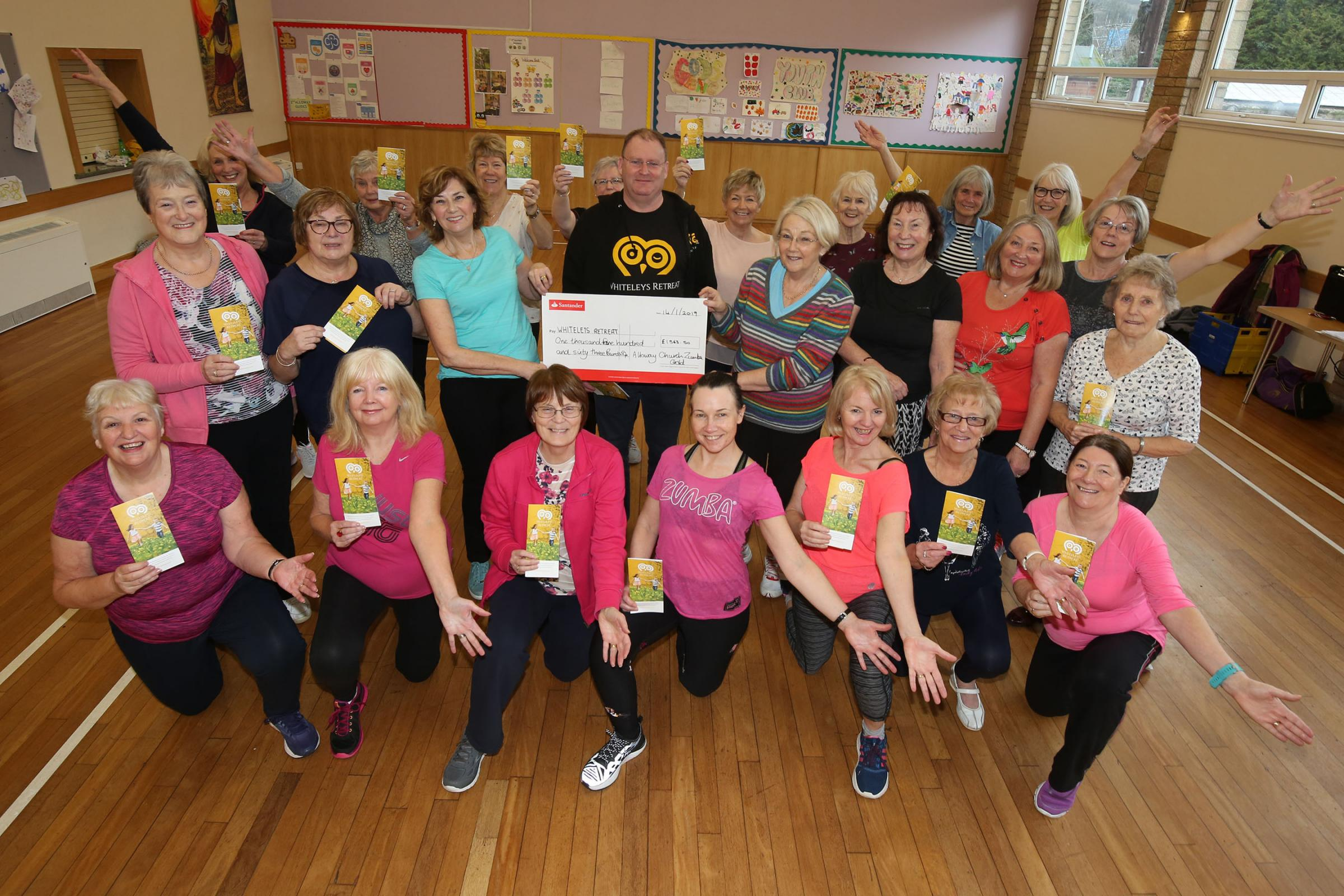 The Zumba ladies presenting their cheque of £1563