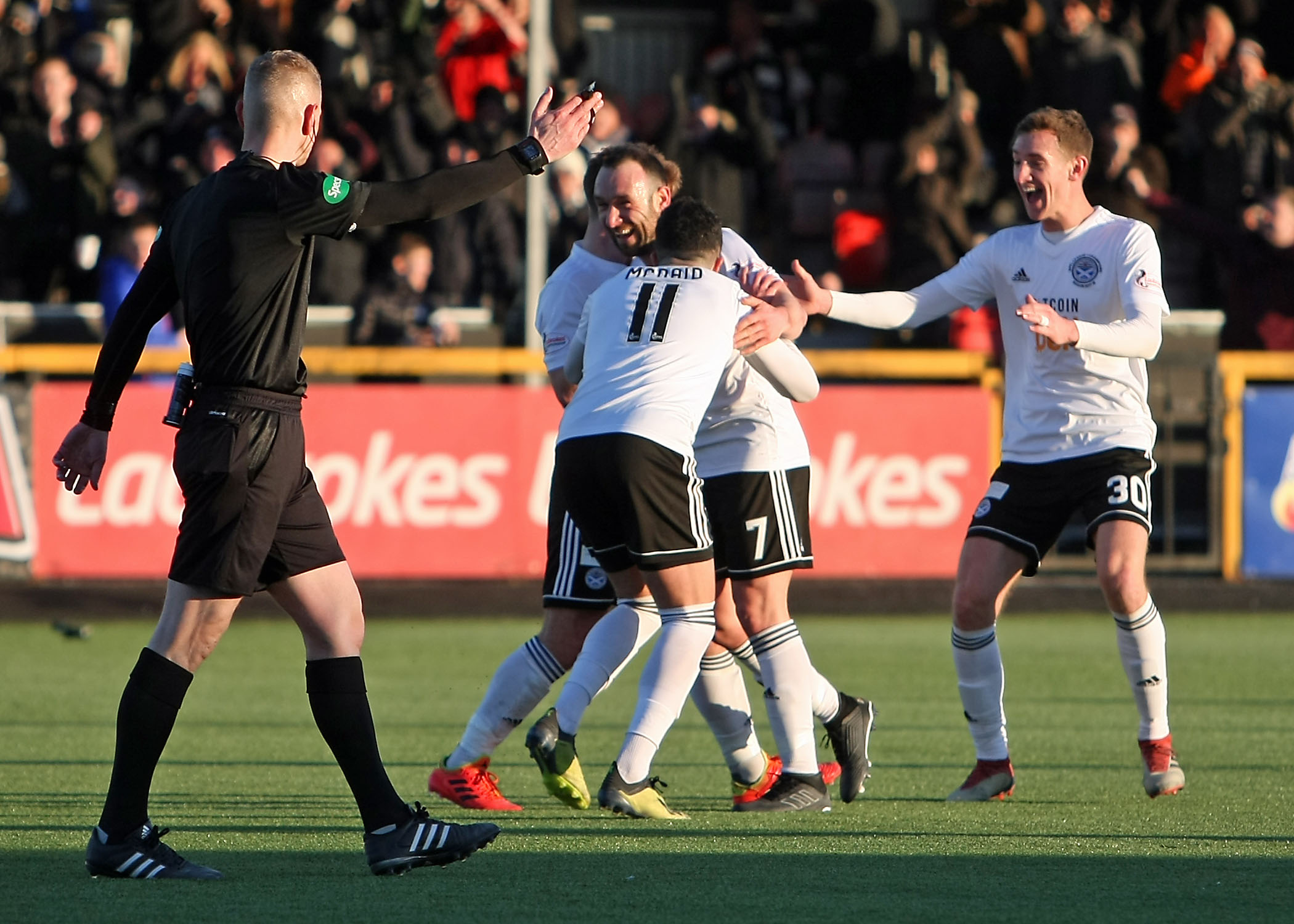 DADDY COOL: Michael Moffat celebrates with team-mates after opening the scoring for Ayr United.