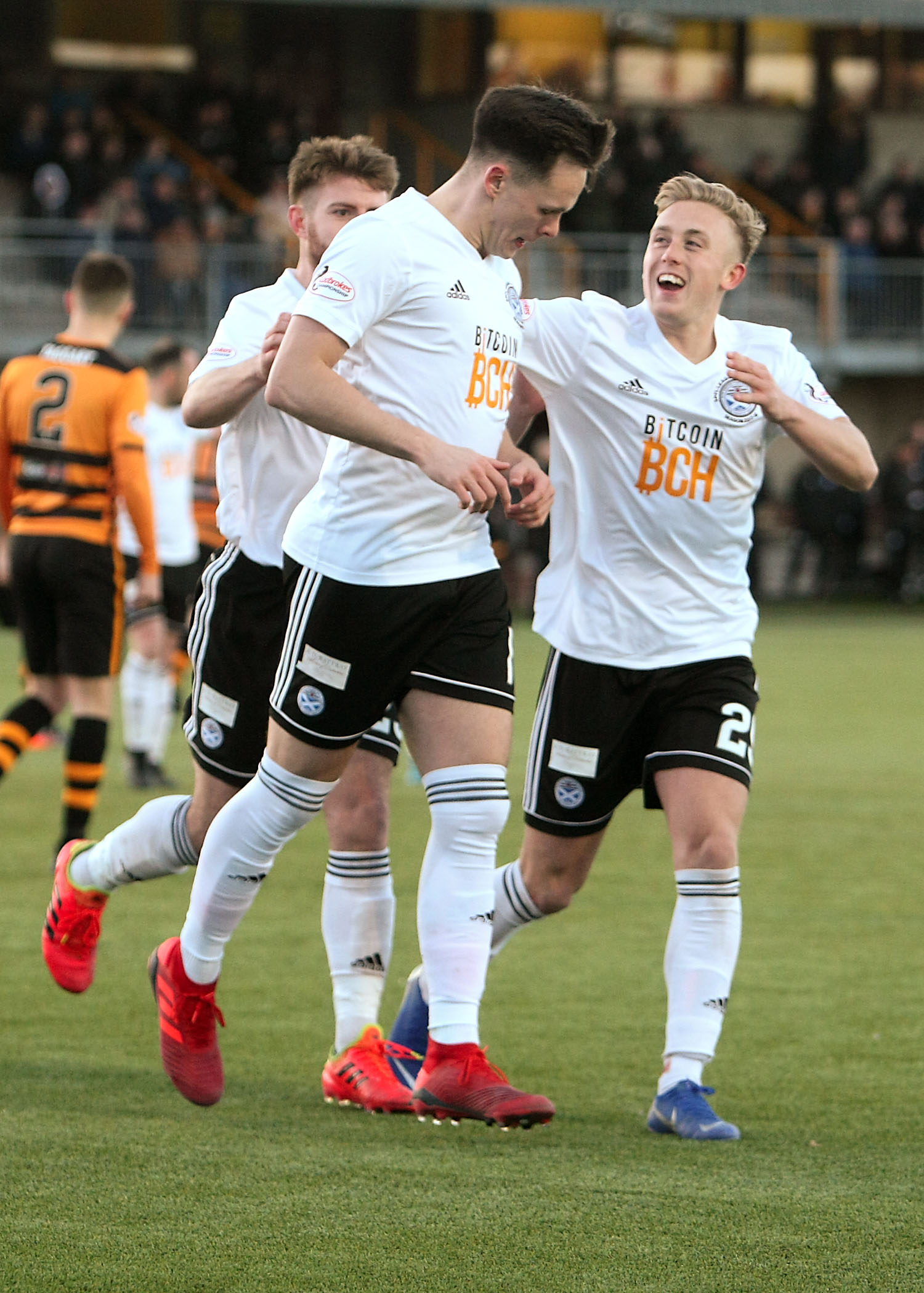 BIG WIN: Lawrence Shankland is congratulated by new signing Calvin Miller after putting Ayr 2-1 ahead from the penalty spot.