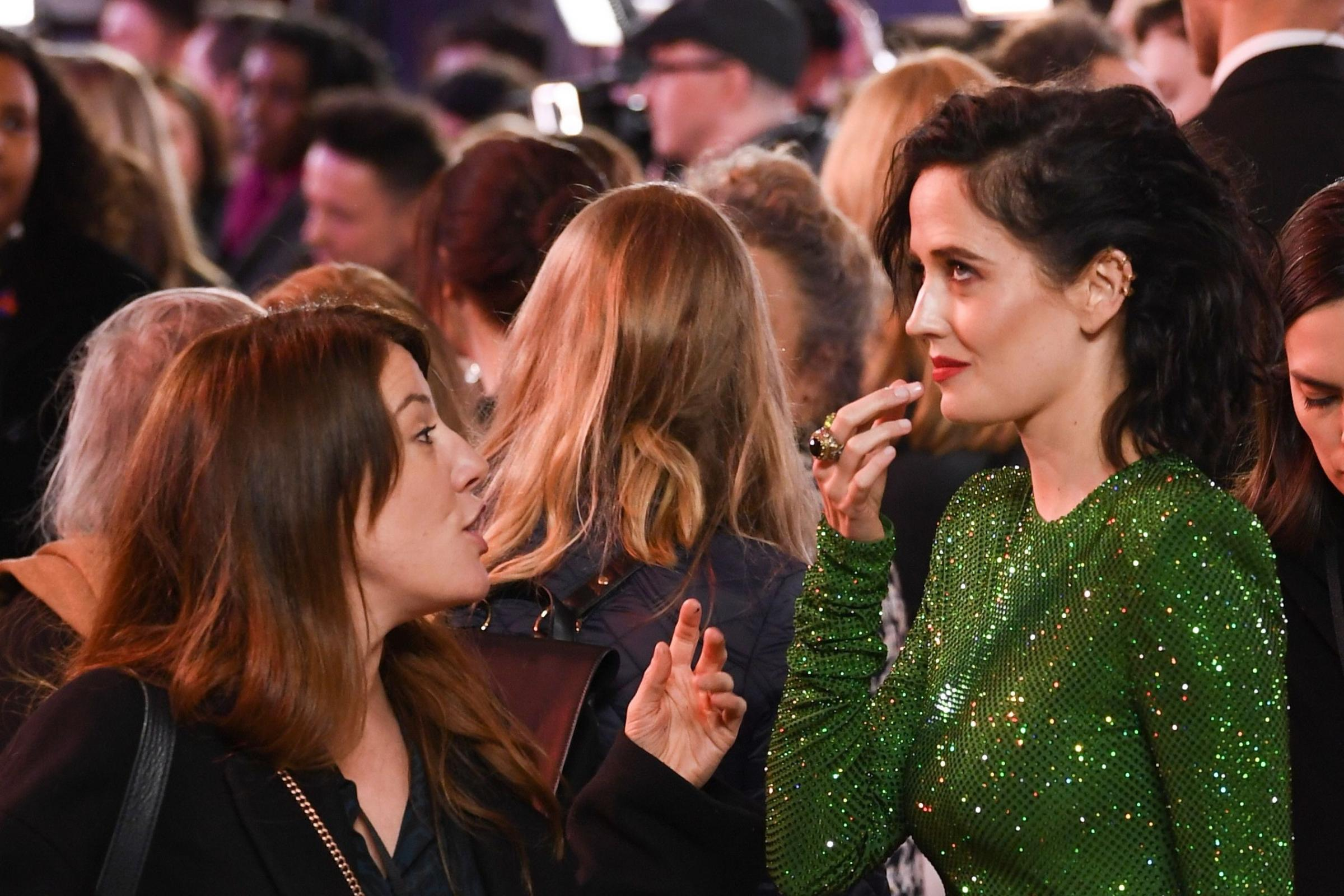 Eva Green takes chewing gum out of her mouth at the Dumbo film premiere