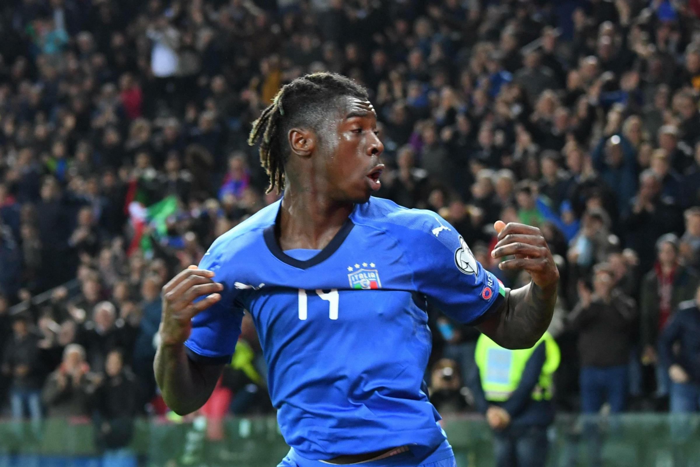 Moise Kean celebrates after scoring his side's second goal against Finland